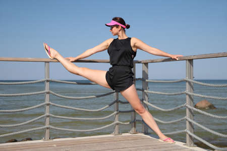 young flexible athletic woman is training stretching