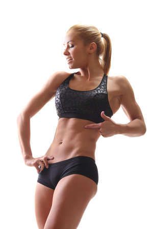 young athletic muscular female body on a white background Foto de archivo - 133742165