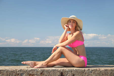 Summer vacation woman young girl in bikini and summer hat