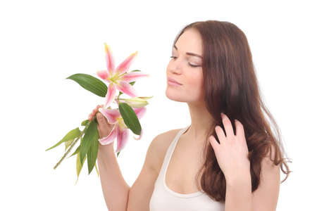 Beauty young face of woman with lily flower