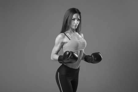 Young pretty boxer woman black and white photo