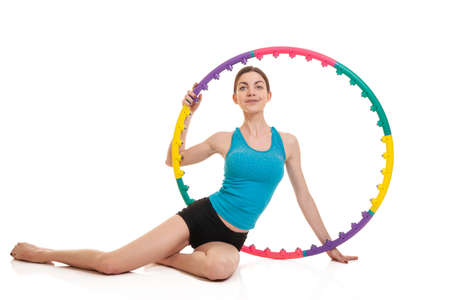young sporty woman with hoop on a white background