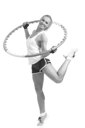 young sporty woman with ring hoop on a white background