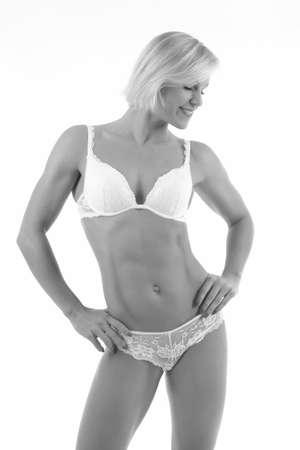 Woman with perfect athletic body . fitness bikini Banco de Imagens