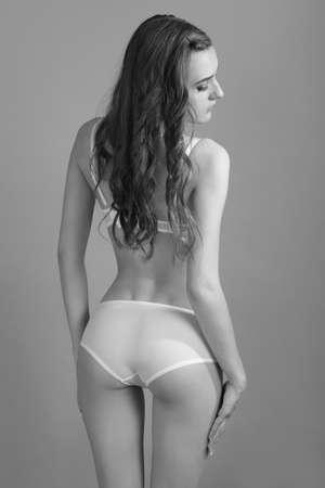 Sexy woman in white lingerie slim figure.
