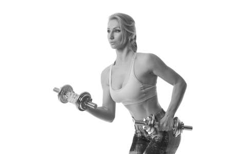 sports woman with dumbbells on a white background Imagens