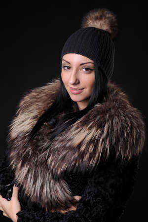 young girl in a woolen hat and a fur coat