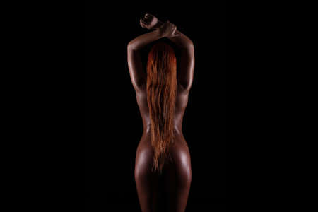 back and butt naked women on dark background