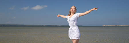 Beautiful  young woman enjoying summer outdoors