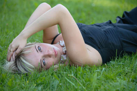 portrait of a young girl on green grass