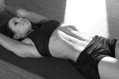 Fitness sexy slim young girl doing exercises