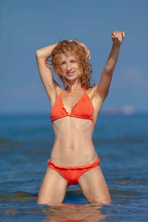Beautiful girl in a bikini on the beach