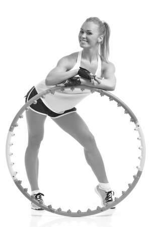 young sporty woman with  hoop on a white background 版權商用圖片
