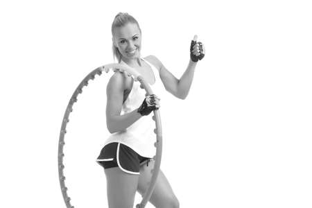 young sporty woman with  hoop on a white background 免版税图像