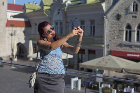 young woman tourist in europe in the city of Tallinn Banco de Imagens