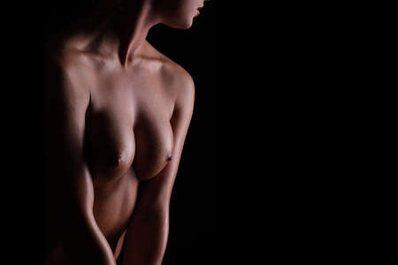 young sexy nude woman on a black background