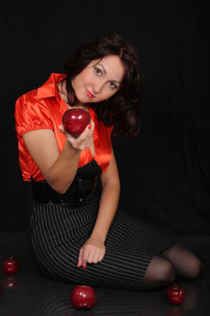 young sexy girl in a red blouse on a black background