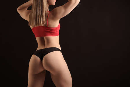 young fitness woman with beautiful athletic body