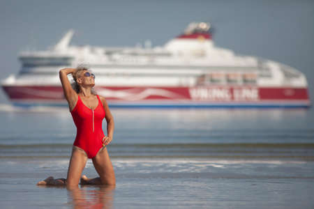 beauty woman in red swimsuit on the beach Stock Photo