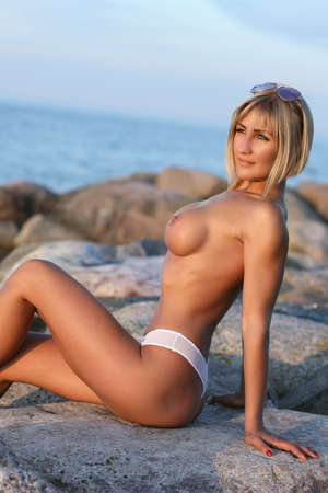 young woman with big on beach