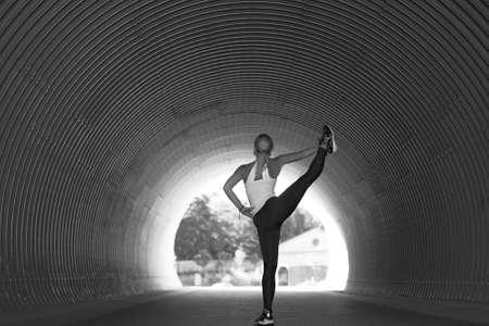 Beautiful young woman doing yoga exercise, Outdoor