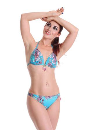 Young beautiful happy woman in bikini on a white background