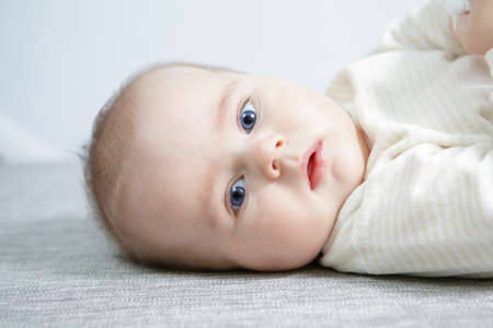 head shoot of cute baby with blue eyes and nice smile   Stock Photo