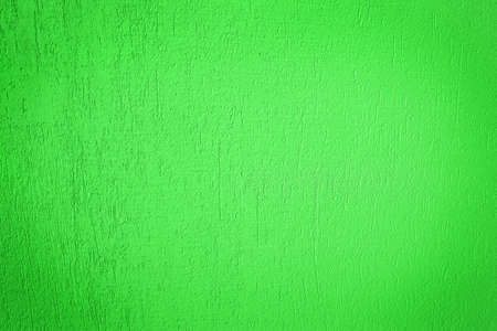 Grain green paint wall background or texture photo