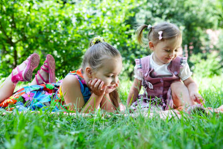 Two little girls playing outdoor