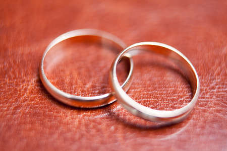 closeup of two gold rings on lather Stock Photo