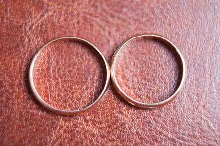lather: closeup of two gold rings on lather Stock Photo