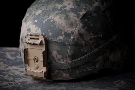 US Army Helmet in low key on blak background Stock Photo