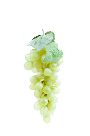 Fake plastic grapes banch on white background photo