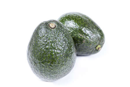 the green avocados isolated on white background