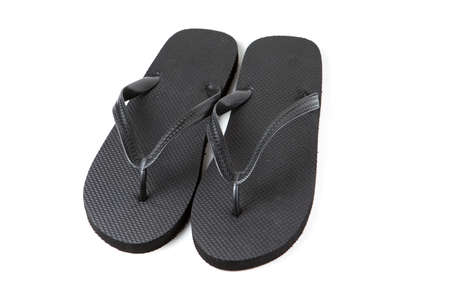 Black flip-flops isolated against a white background photo