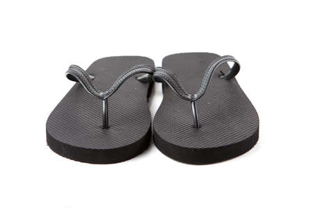 Black flip-flops isolated against a white background Stock Photo - 20284770