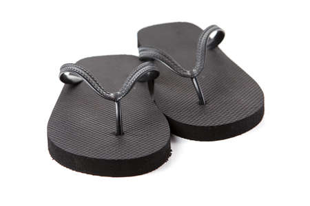 Black flip-flops isolated against a white background Stock Photo - 20284807