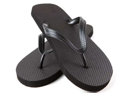 Black flip-flops isolated against a white background Stock Photo - 20284817