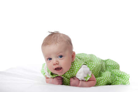 Cute infant girl in green dress on white background Reklamní fotografie