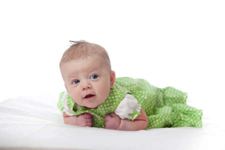 generration: Cute infant girl in green dress on white background Stock Photo