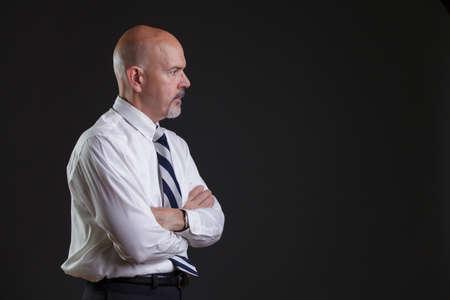 strip shirt: Businessman in white shirt and big strip tie looking thinking.