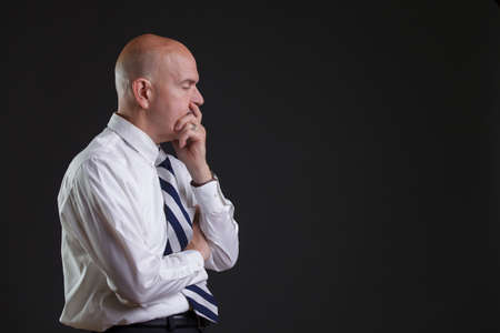 strip shirt: Businessman in white shirt and big strip tie looking desperate Stock Photo