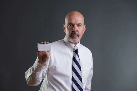 strip shirt: Businessman in white shirt and big strip tie holding business card Stock Photo