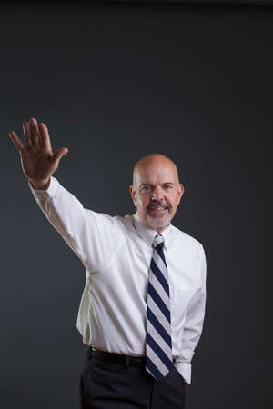 strip shirt: Businessman in white shirt and big strip tie giving a wave