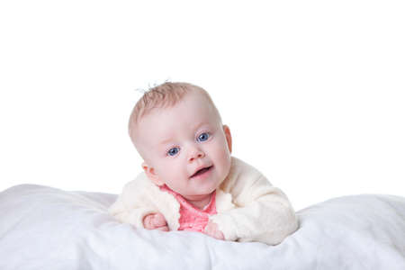 Cute baby-girl in pink dress, on her tummy isolated