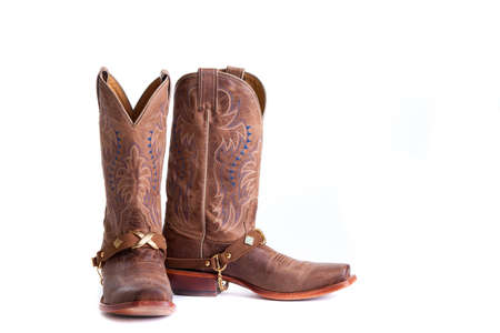 Cowboy boots isolated on white background photo