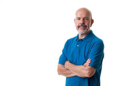 Portrait of mature man in blue polo shirt fold his arms isolated on white Stock Photo