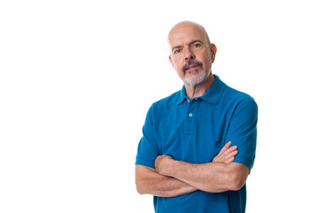 Portrait of mature man in blue polo shirt fold his arms isolated on white Imagens