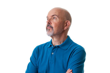 Close up Portrait of mature man in blue polo shirt looking away isolated on white Stock Photo