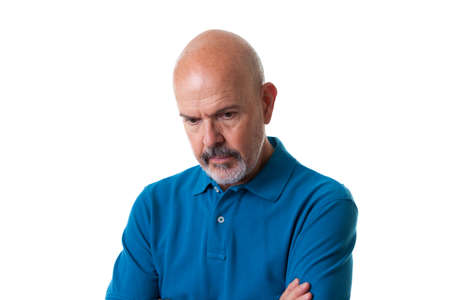 Close up Portrait of mature man in blue polo shirt looking down isolated on white